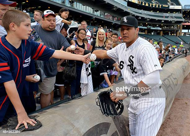 Avisail Garcia of the Chicago White Sox signs autographs for fans before the game against the Cleveland Indians at US Cellular Field on August 27...