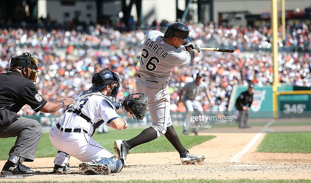 Avisail Garcia #26 of the Chicago White Sox singles to left field scoring Conor Gillaspie #12 during the fifth inning of the game against the Detroit Tigers at Comerica Park on September 22, 2013 in Detroit, Michigan.
