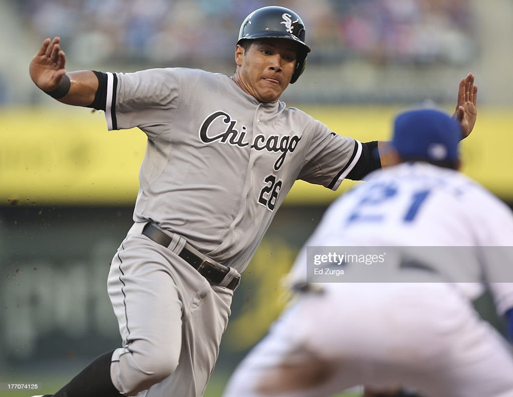 Avisail Garcia #26 of the Chicago White Sox slides into third as he is tagged out by <a gi-track='captionPersonalityLinkClicked' href=/galleries/search?phrase=Jamey+Carroll+-+Baseball+Player&family=editorial&specificpeople=211176 ng-click='$event.stopPropagation()'>Jamey Carroll</a> #21 of the Kansas City Royals as he tries to advance on a fielders' choice in the second inning at Kauffman Stadium August 20, 2013 in Kansas City, Missouri.