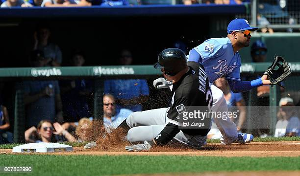Avisail Garcia of the Chicago White Sox slides into third for a triple past Christian Colon of the Kansas City Royals in the second inning at...