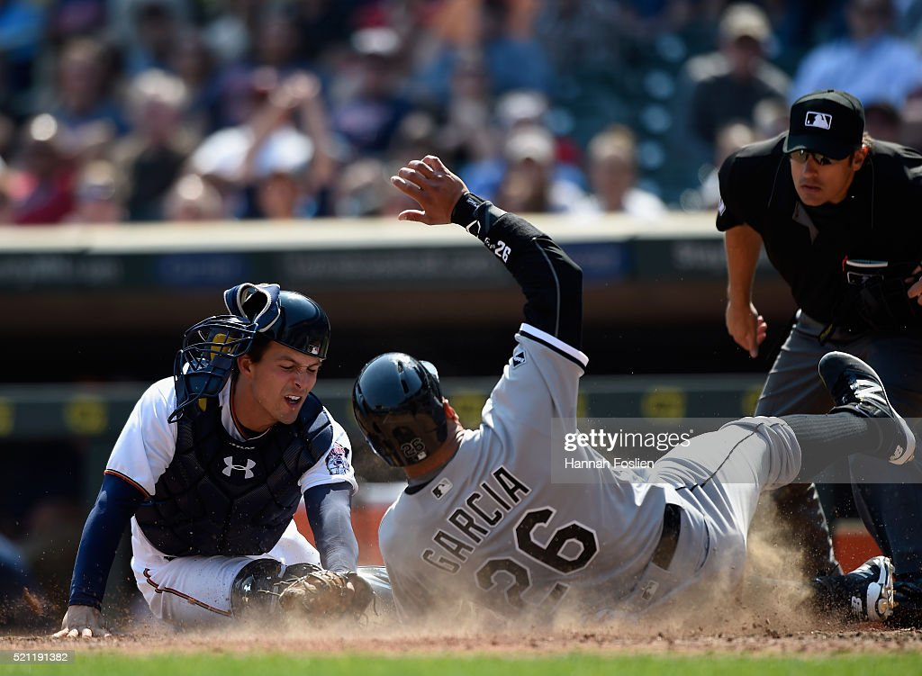 Avisail Garcia #26 of the Chicago White Sox slides safely into home plate as John Ryan Murphy #12 of the Minnesota Twins applies the tag during the seventh inning of the game on April 14, 2016 at Target Field in Minneapolis, Minnesota. The White Sox defeated the Twins 3-1.