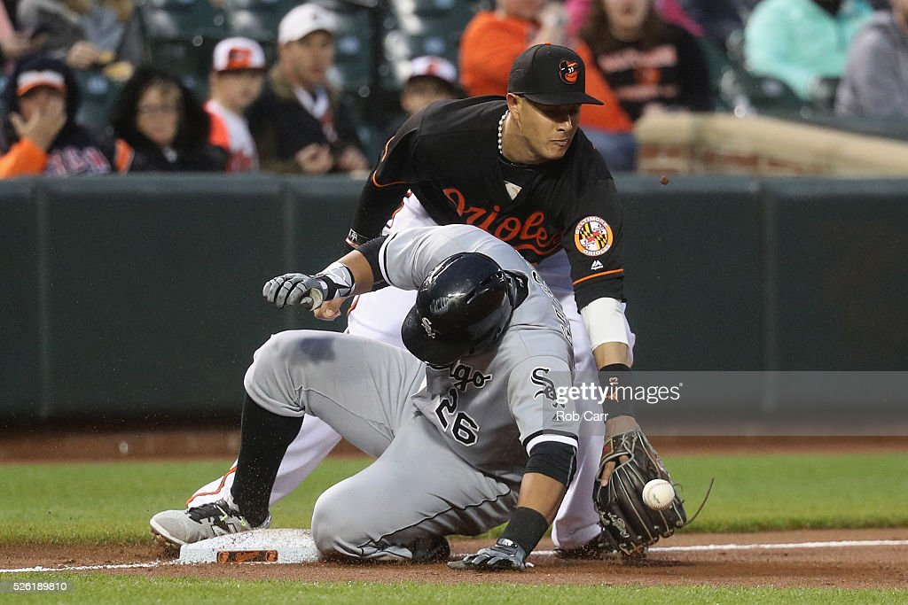 Avisail Garcia #26 of the Chicago White Sox slides under the tag of third baseman <a gi-track='captionPersonalityLinkClicked' href=/galleries/search?phrase=Manny+Machado&family=editorial&specificpeople=5591039 ng-click='$event.stopPropagation()'>Manny Machado</a> #13 of the Baltimore Orioles for an RBI triple in the second inning at Oriole Park at Camden Yards on April 29, 2016 in Baltimore, Maryland.