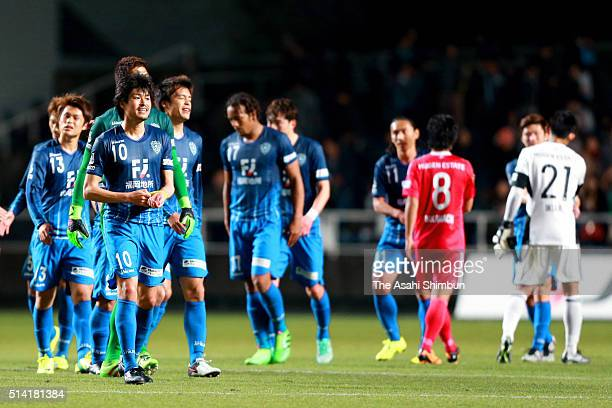 Avispa Fukuoka players react after their 11 draw in the JLeague match between Avispa Fukuoka and Yokohama FMarinos at the Level 5 Stadium on March 5...