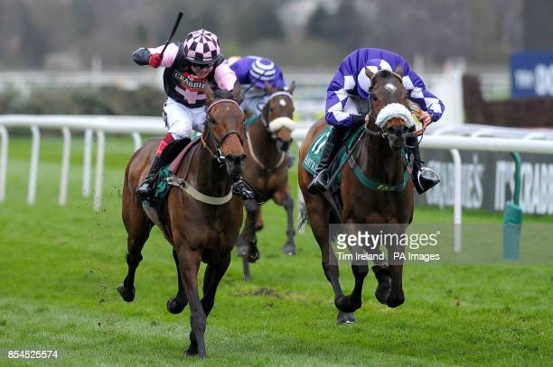 Avispa ridden by Robert Thornton wins the Concerto Group Mares' Standard Open National Hunt Flat Race during Ladies Day of the Crabbie's Grand...