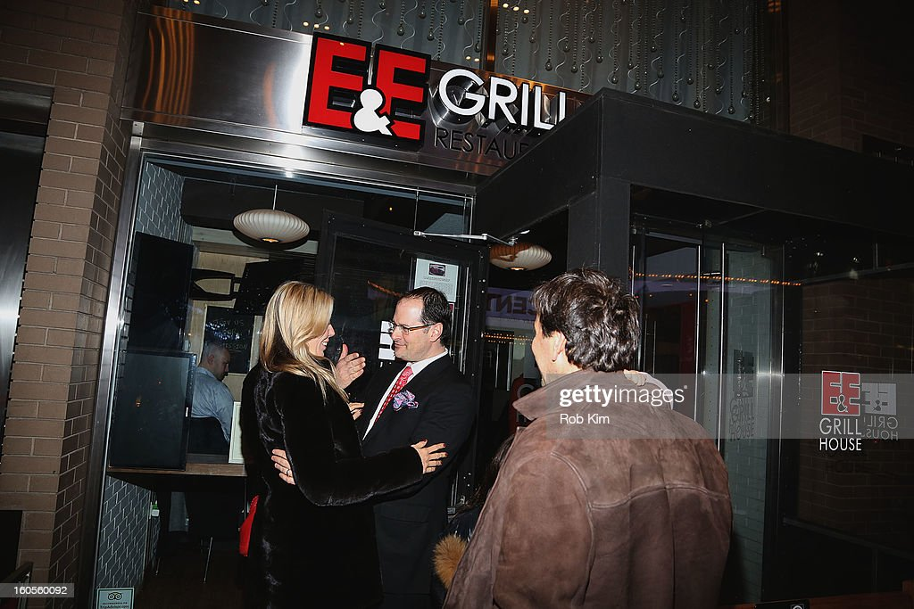Aviva Drescher and her husband Reid Drescher greet Eric Perlmutter (C), co-owner of E&E Grill House, as they arrive for dinner at E&E Grill House restaurant and bar on February 2, 2013 in New York City.