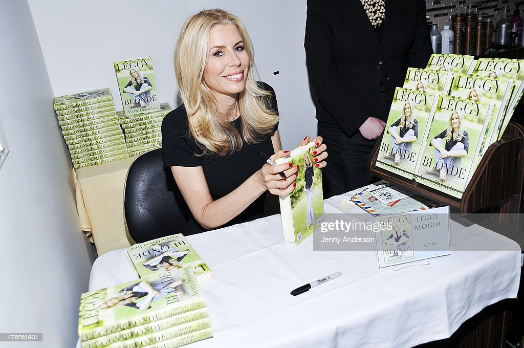 Aviva Drescher signing books at the 'Leggy Blonde' book launch celebration at Angelo David Salon on March 12, 2014 in New York City.