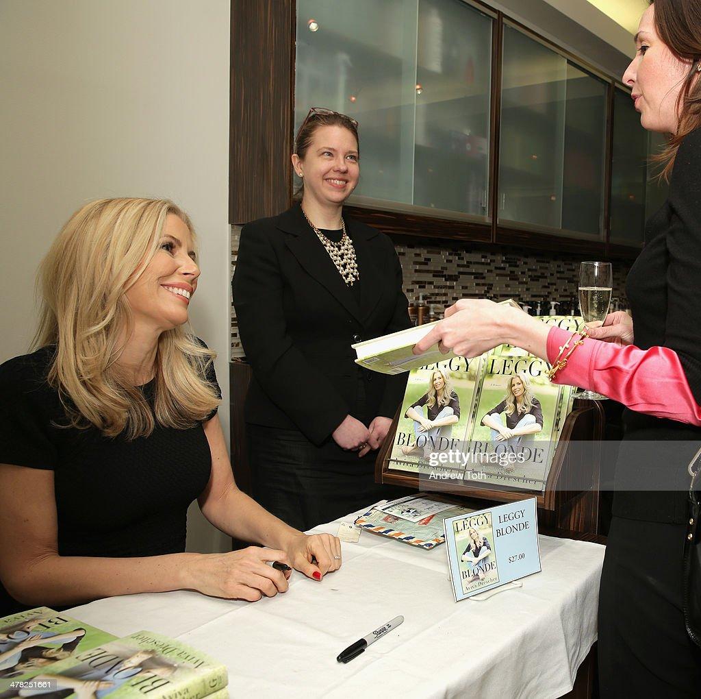 Aviva Drescher signs her book during Aviva Drescher's 'Leggy Blonde' book launch celebration at Angelo David Salon on March 12, 2014 in New York City.