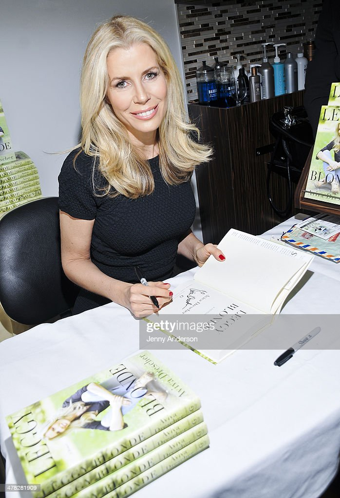 Aviva Drescher signs her book 'Leggy Blonde' at book launch celebration at Angelo David Salon on March 12, 2014 in New York City.