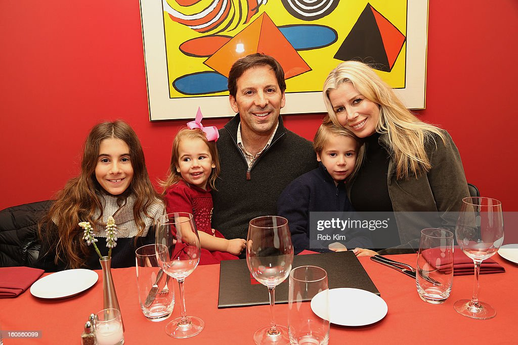 Aviva Drescher, with her husband Reid Drescher and their children, arrive for dinner at E&E Grill House restaurant and bar on February 2, 2013 in New York City.