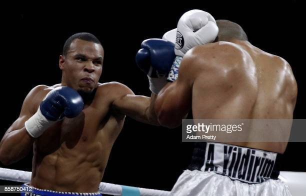 Avni Yildirim of Turkey and Chris Eubank Jr of Great Britain exchange punches during the Super Middleweight World Boxing Super Series fight at...