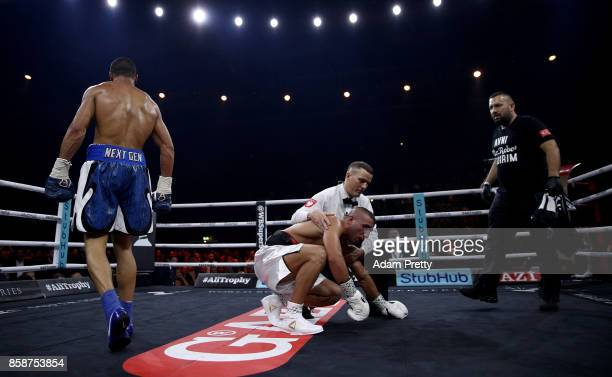 Avni Yildirim of Turkey is knocked down by Chris Eubank Jr of Great Britain during the Super Middleweight World Boxing Super Series fight at...