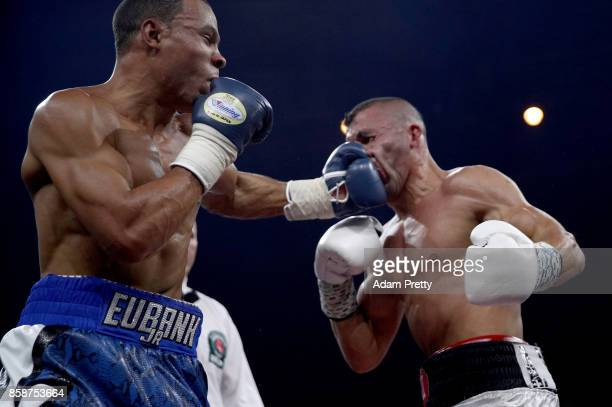 Avni Yildirim RL of Turkey is hit by Chris Eubank Jr of Great Britain exchange punches during the Super Middleweight World Boxing Super Series fight...