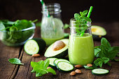 Green detox smoothie with avocado, cucumber and fresh mint