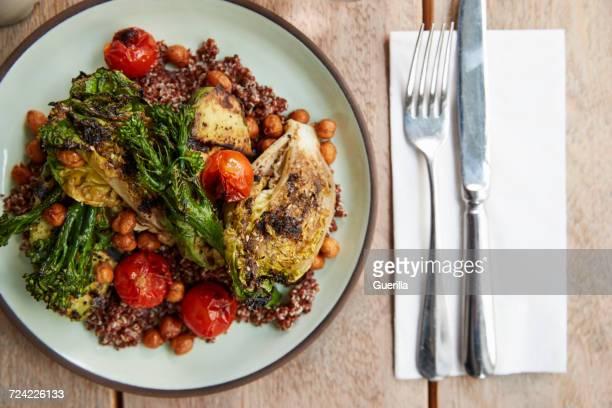Avocado, broccolini, chickpea, quinoa salad, overhead view