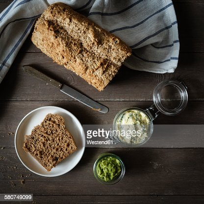 Avocado cream, herb butter and wholemeal spelt bread