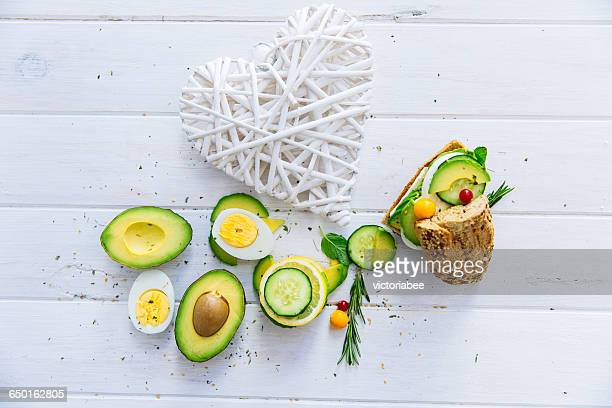 Avocado, egg and cucumber sandwich with  heart shape decoration