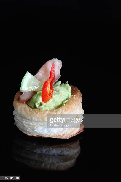 Avocado mousse with smoked fish in puff pastry