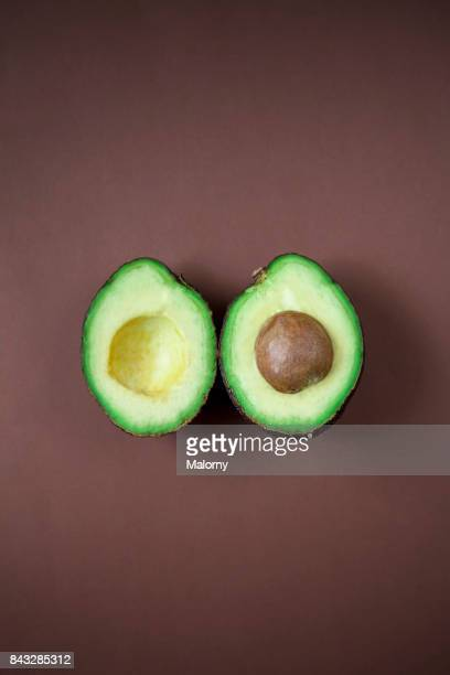 Avocado on brown background. Greenery