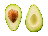Two slices of avocado isolated on the white background. One slice with core.