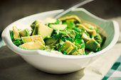Avocado, ramson and cucumber salad with dill, parsley, and avocado-crape seed oil
