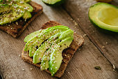Avocado Toast On A Wooden Cutting Board