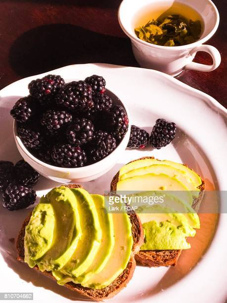 Avocado toast with blackberries and green tea