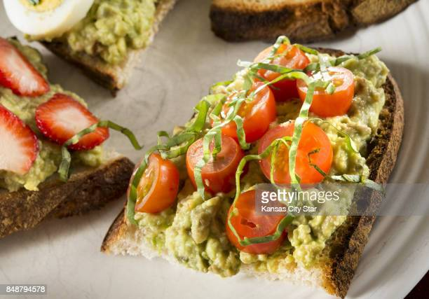 Avocado toast with cherry tomatoes and basil