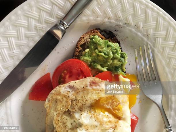 Avocado toast with fried eggs and tomatoes