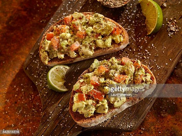 Avocado Toast with Tomatoes on Rye Bread