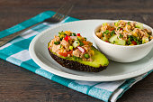 Avocado stuffed with tuna and fresh vegetables