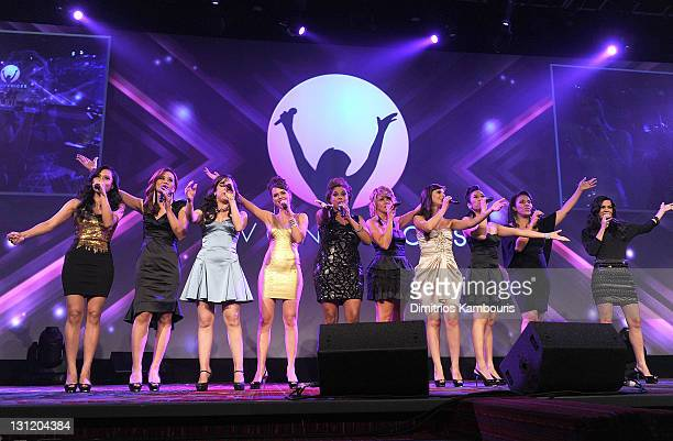 Avon Voices Finalists sing onstage at the celebration of Avon's 125th Anniversary at the Avon Foundation Global Voices for Change Gala at Marriott...