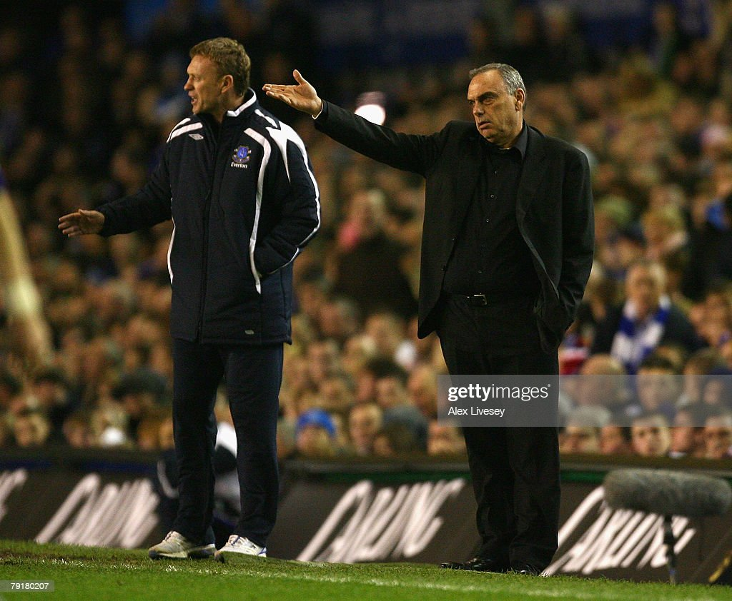 Avram Grant the manager of Chelsea and David Moyes the manager of Everton shout directions to their players during the Carling Cup Semi Final 2nd Leg match between Everton and Chelsea at Goodison Park on January 23, 2007 in Everton, England.