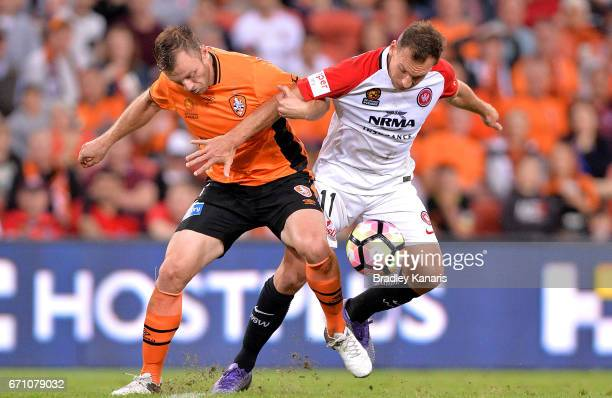Avram Papadopoulos of the Roar and Brendan Santalab of the Wanderers challenge for the ball during the ALeague Elimination Final match between the...