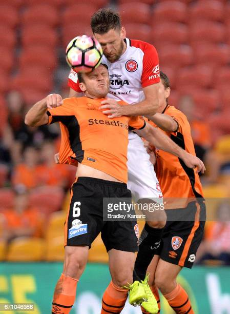Avram Papadopoulos of the Roar and Robert Cornthwaite of the Wanderers challenge for the ball during the ALeague Elimination Final match between the...