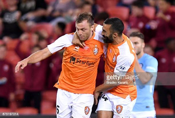 Avram Papadopoulos of the Roar celebrates scoring a goal during the round seven ALeague match between Brisbane Roar and Melbourne City at Suncorp...