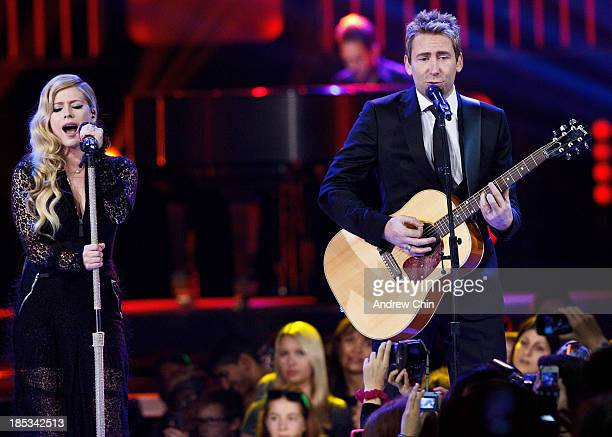 Avril Lavigne and Chad Kroeger performing on We Day at Rogers Arena on October 18 2013 in Vancouver Canada