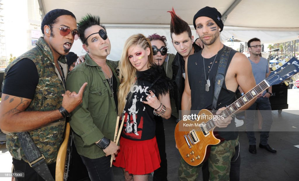 <a gi-track='captionPersonalityLinkClicked' href=/galleries/search?phrase=Avril+Lavigne&family=editorial&specificpeople=171190 ng-click='$event.stopPropagation()'>Avril Lavigne</a> (C) and her band attend the iHeartRadio Music Festival Village on September 21, 2013 in Las Vegas, Nevada.