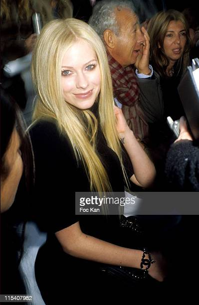 Avril Lavigne Gilles Bensimon and Guest during Paris Fashion Week Haute Couture Spring Summer 2006 Chanel at Grand Palais in Paris France