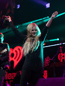 Avril Lavigne performs at the 1035 KISS FM's Jingle Ball 2013 at United Center on December 9 2013 in Chicago Illinois