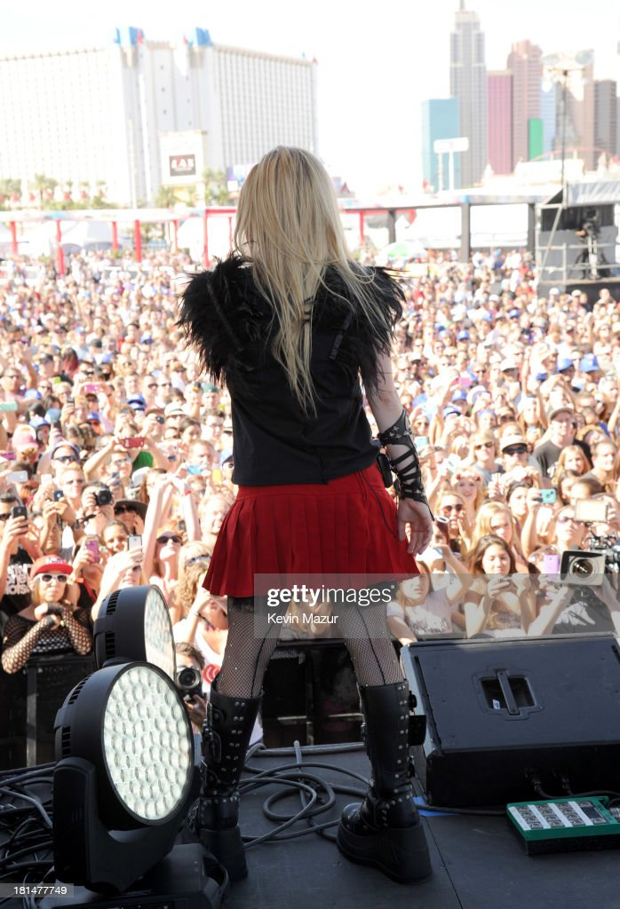 <a gi-track='captionPersonalityLinkClicked' href=/galleries/search?phrase=Avril+Lavigne&family=editorial&specificpeople=171190 ng-click='$event.stopPropagation()'>Avril Lavigne</a> performs at the iHeartRadio Music Festival Village on September 21, 2013 in Las Vegas, Nevada.
