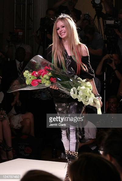 Avril Lavigne poses attends her Abbey Dawn by Avril Lavigne Spring 2012 fashion show during Style360 at the Metropolitan Pavilion on September 12...