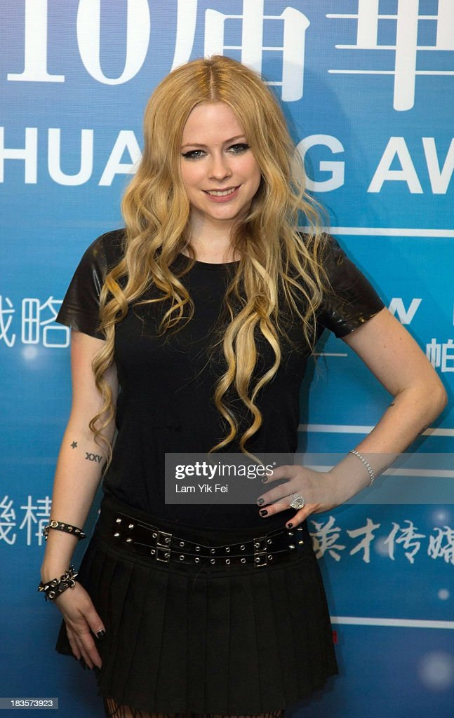 Avril Lavigne poses for photograph after winning Best Global Singer at the 2013 Huading Awards ceremony at The Venetian on October 7 2013 in Macau...