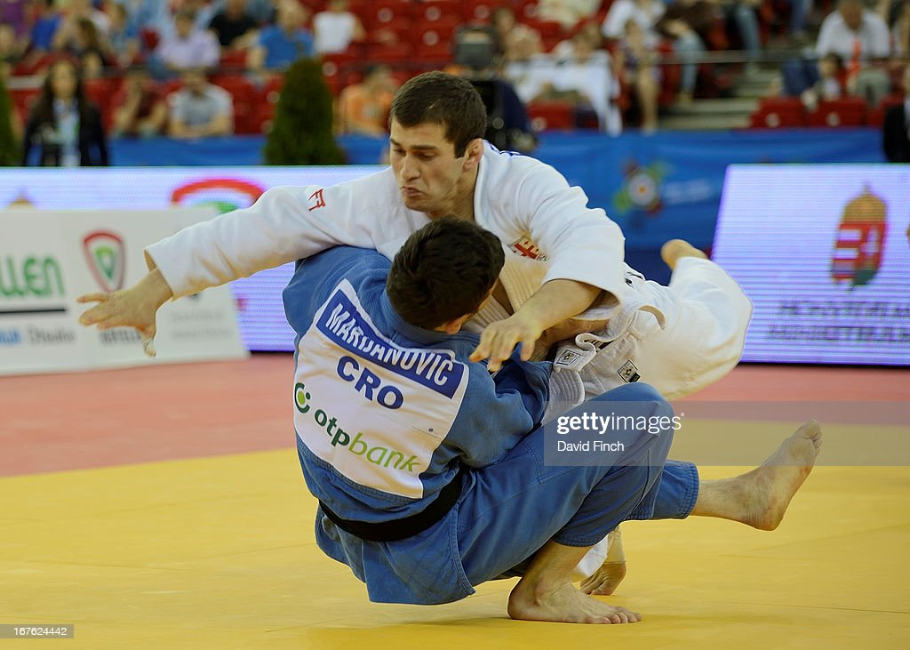<a gi-track='captionPersonalityLinkClicked' href=/galleries/search?phrase=Avtandil+Tchrikishvili&family=editorial&specificpeople=8082760 ng-click='$event.stopPropagation()'>Avtandil Tchrikishvili</a> of Georgia (white) narrowly defeats Tomislav Marijanovic of Croatia to win the u81kgs final at the Budapest European Championships held at the Papp Laszlo Sports Hall on April 26, 2013 in Budapest, Hungary.