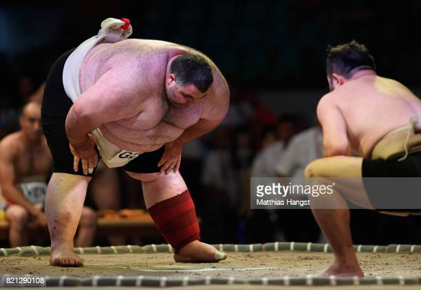 Avtandil Tsertsvadze of Georgia competes against Takahiro Higuchi of Brazil during the Sumo Open Weight Men's Competition of The World Games at...