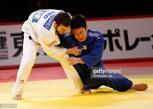 Avtandili Tchrikishvili of Georgia and Lee Seungsu of South Korea compete in the Men's 81kg final at Tokyo Metropolitan Gymnasium on December 5 2015...