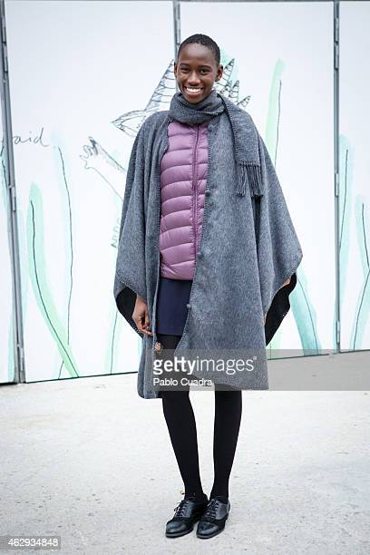 Awa wears Shoes Piel boots Zara coat and Mango dress during Mercedes Benz Madrid Fashion Week Fall/Winter 2015/16 at Ifema on February 7 2015 in...