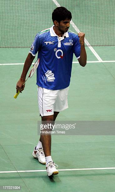 Awadhe Warriors player K Srikanth reacts after winning a point during his match against Krrish Delhi Smashers player B Sai Praneeth in the Indian...