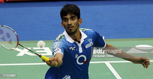 Awadhe Warriors player K Srikanth smashes during his match against Krrish Delhi Smashers player B Sai Praneeth in the Indian Badminton League at Shri...