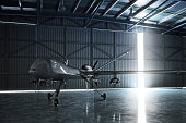 Lone drone U.A.V aircraft awaiting a military mission in a hanger. 3d model scene.