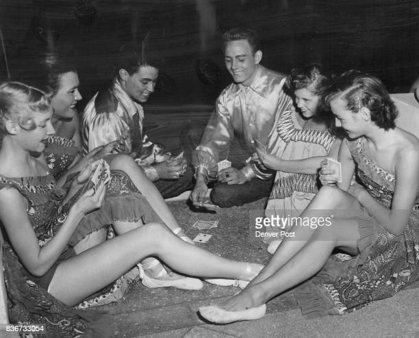 Awaiting their curtain call a group of Florence Kessler dancers indulges in a game of cards in an outoftheway corner behind scenes at the opera From...